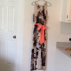 Hi-Low Hem, floral dress with gold necklace neck.